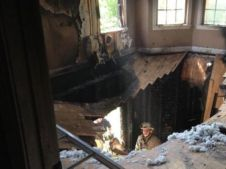FIREMAN NARROWLY ESACAPES FLOOR COLLAPSE